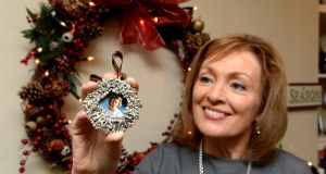 Mary Kennedy hangs a silver-framed photograph of her late mother Pauline on the tree every year. Photograph: Cyril Byrne