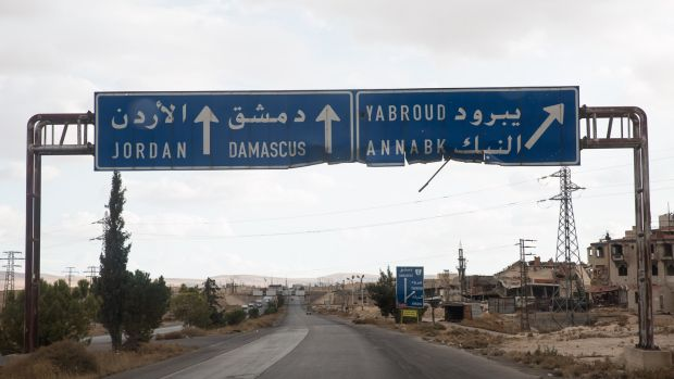 A Syrian sign shows the road to Damascus. Photograph: Sally Hayden
