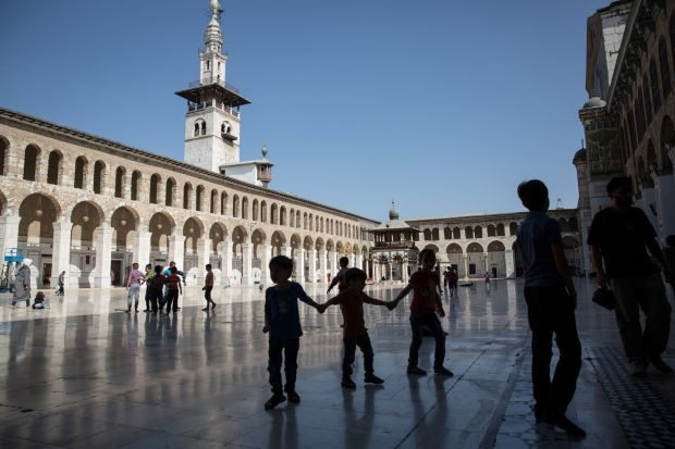 Children play in the Umayyad mosque in Damascus, from which you can still hear the regular sound of bombing in the nearby opposition-held East Ghouta and Jobar suburbs. Photograph: Sally Hayden
