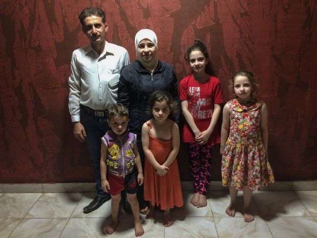 Mohamed Ma'rouf, a Syrian refugee who fought a court case to be allowed take his documents back so he could leave Germany, now lives with his wife and four daughters in Khartoum, Sudan. They were reunited 10 days before this photo was taken. Photograph: Sally Hayden