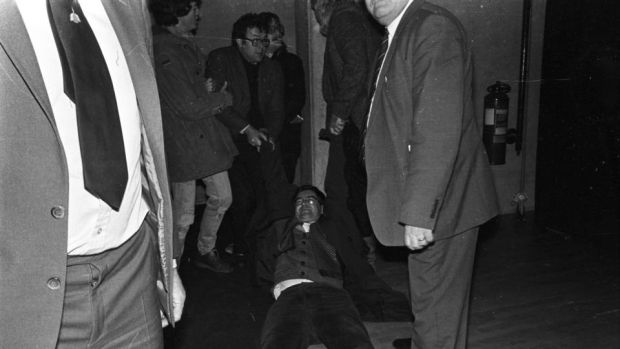 """My father was slightly embarrassed by my radicalism"": Joe Duffy is removed from a meeting at Trinity College Dublin in 1984, when he was students' union president. Photograph: Kevin McMahon"
