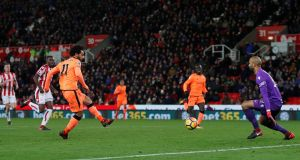 Liverpool's Mohamed Salah scores their third goal in a 3-0 win over Stoke. Photo: Eddie Keogh/Reuters