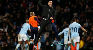 Manchester City manager Pep Guardiola celebrates after Raheem Sterling scored the winner late on in their victory over Southampton. Photo: Andrew Yates/Reuters