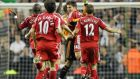 Liverpool's Xabi Alonso celebrates with his teammates after scoring from inside his own half against Newcastle in 2006. Photograph: Getty Images