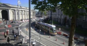 The  Luas Cross City on College Green passing Trinity College en-route to Nassau Street. Photograph Nick Bradshaw