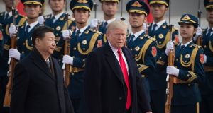 China's president Xi Jinping and US president Donald Trump reviewing Chinese honour guards during a welcome ceremony at the Great Hall of the People in Beijing on November 9th. File photograph: Nicolas Asfouri/AFP/Getty Images