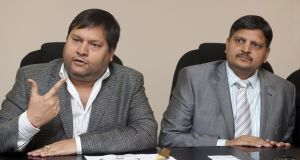 Ajay (left) and Atul Gupta. Photograph: Getty Images