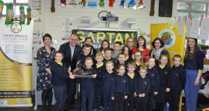 Minister Joe McHugh TD presents the Gartan NS students (and teachers) with the National 'Something Fishy' Trophy.