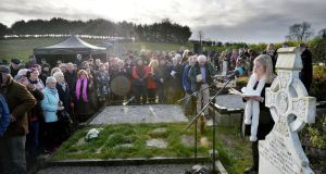 "Novena of poems:   Caitríona Ní Chléirchín   reads ""In Memory of My Mother"" at the graveside of  Patrick Kavanagh in Inniskeen, Co Monaghan, as part of a tribute to mark the 50th anniversary of  his death. Photograph: Alan Betson/The Irish Times"