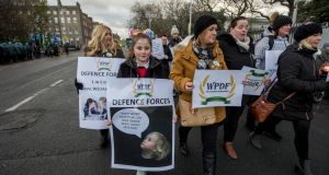 Wives and Partners of  Defence Forces, a group set up to highlight the relatives' poor pay and working conditions, march to  the Dáil. Photograph: Brenda Fitzsimons / The Irish Times