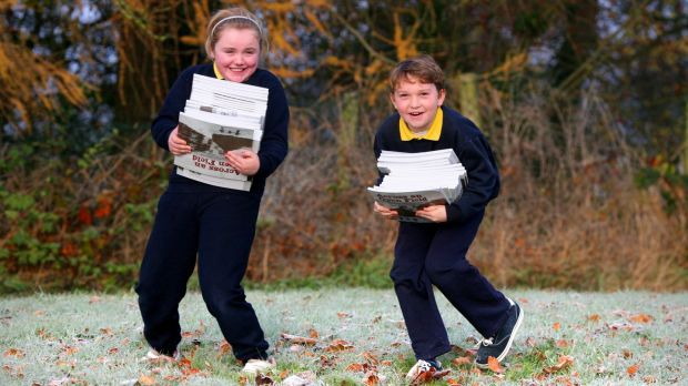 Aimee Dunne and Killian Lacey, pupils from Lisnafunchin National School, Castlecomer, Co Kilkenny, carry copies of Across and Open Field to the Kilkenny Education Centre. Photograph: Brian Farrell