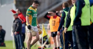 Kilcormac-Killoughey's Cillian Kiely leaves the pitch after being  sent off during the Leinster championship victory over   Mount Leinster Rangers. Photograph: Bryan Keane/Inpho