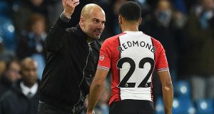 Manchester City's Catalan manager Pep Guardiola talks with Southampton's Nathan Redmond at the Etihad Stadium. Photograph: Getty Images