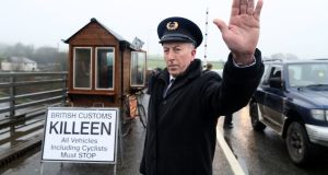 "A mock customs checkpoint on the Irish Border earlier this year. ""Ireland insists Britain must make a political declaration, promising to avoid the kind of regulatory divergence that would have the effect of hardening the Border."" File photograph: Paul FAITH/AFP/Getty Images"