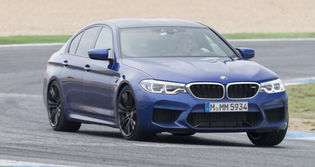 new bmw m5 marries monster power to air of anachronism