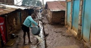 Washing up in Nairobi. Shalom works extensively in the Kibera slum in Nairobi, the biggest slum in Africa. Kibera is home to  250,000 of the 2.5m  slum dwellers in the city. Photograph: Getty Images