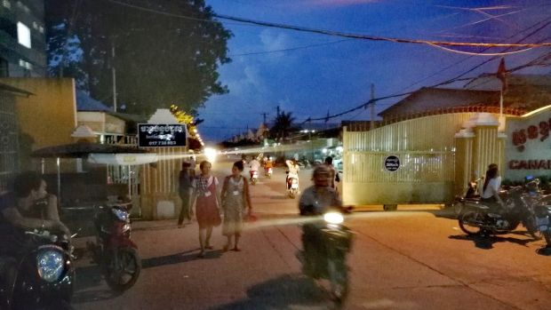 Garment workers coming off shift at a factory on the outskirts of Phnom Penh. Cambodia's economy relies heavily on garment exports to the EU. Photograph: Nevenka Lukin