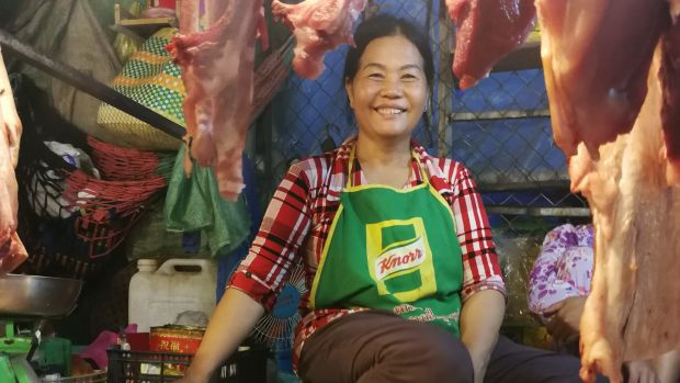 A woman sells meat at a market in Phnom Penh. Photograph: Nevenka Lukin