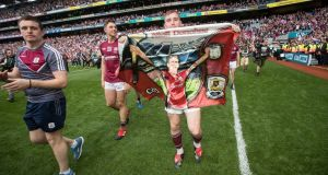 Galway's Conor Whelan celebrates after the All-Ireland final win with a Galway flag bearing Niall's image. Photograph: Ryan Byrne/Inpho