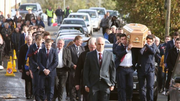 The remains of Niall Donoghue are carried by hurling colleagues through Kilbeacanty. Photograph: Joe O'Shaughnessy