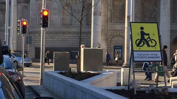 "The National Transport Authority says it is installing a number of ""cyclists dismount"" signs ""because of safety concerns""."