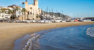The church of San Bartolomé y Santa Tecla and the beach in Sitges, a small town near Barcelona. File photograph: iStockPhoto