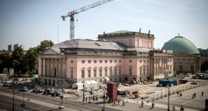 The Staatsoper under construction: The state opera house was supposed to reopen four years ago at a cost of €240 million. Instead it has taken twice as long and, at €400 million, has proven almost twice as expensive. Photograph: Gordon Welters