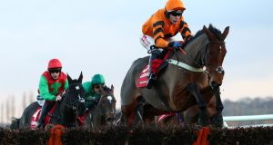Thistlecrack ridden by Tom Scudamore runs in the Ladbrokes Long Distance Hurdle during day one of the The Ladbrokes Winter Carnival at Newbury Racecourse. Photo: Tim Goode/PA Wire