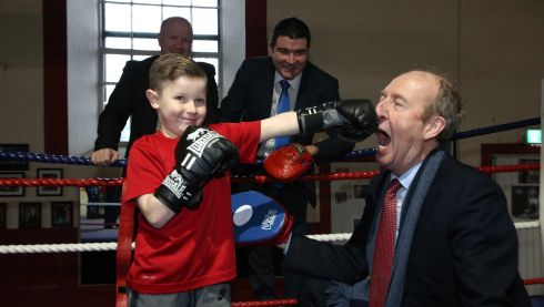 THURSDAY: Kalvin Keenan (10) from Arbour Hill sparring with Minister for Sport Shane Ross as Olympic medallist Michael Carruth and Minister of State for Sport Brendan Griffin look on in the Arbour Hill Boxing Club. Photograph: Sam Boal/Rollingnews.ie