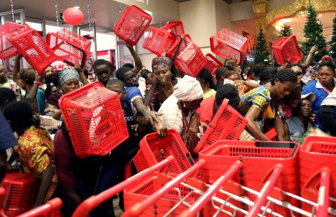 THURSDAY: People reached out to pick baskets at a newly commissioned Shoprite store at Novare Gateway mall Abuja, Nigeria. Afolabi Sotunde/Reuters