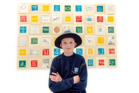 Fourth-class student Brian Cantwell at St Mary's of The Isle School, Cork city wearing a hat that belonged to his great-grandmother Namie O'Riordan at an exhibition in Cork City Hall. She died three weeks ago. Photograph: Michael Mac Sweeney/Provision