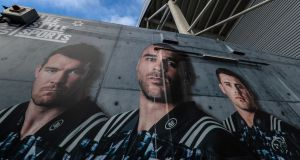 Munster branding featuring  Peter O'Mahony, Simon Zebo and CJ Stander. Photograph: Billy Stickland/Inpho