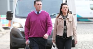 Garda Keith Harrison and  Marisa Simms: his solicitor said Garda Harrison  would continue suing the Garda Commissioner, the Minister for Justice, Ireland and the Attorney General. File photograph: Stephen Collins/Collins Photos