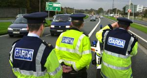 Gardaí operating a speed camera as part of a penalty points for speeding operation. Photograph: Cyril Byrne