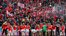 Cuala celebrate their victory over Ballyea  in the All-Ireland club final last March. Photograph:  Tommy Dickson/Inpho
