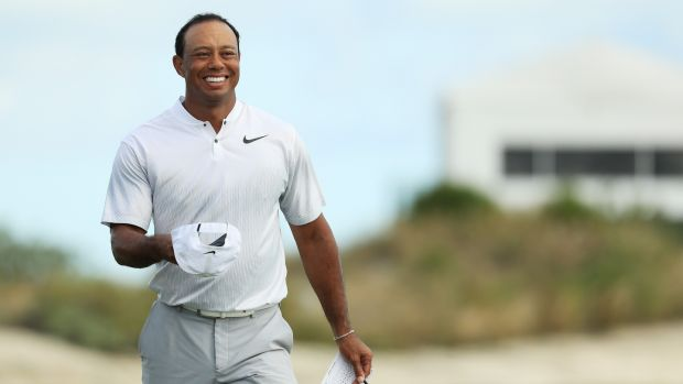 Woods smiles as he leaves the 18th green. Photo: Mike Ehrmann/Getty Images