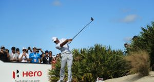 Tiger Woods plays his shot from the fourth tee during the second round of the Hero World Challenge at Albany, Bahamas. Photo: Mike Ehrmann/Getty Images