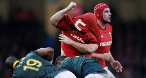 Wales' Scott Andrews after his shirt is pulled over his head. Photograph: Andrew Boyers/Reuters
