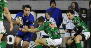 Leinster's James Lowe cuts through the  Benetton Treviso defence. Photograph: Elena Barbini/Inpho