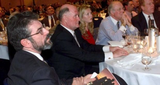 Businessman Pat Donaghy (centre) beside Sinn Féin president Gerry Adams listens at a fund-raiser for the party in New York in 1999. Photograph: AP Photo/Mark Lennihan