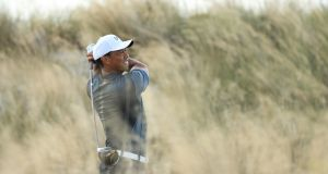 Tiger Woods of the United States plays his shot from the third tee during the third round of the Hero World Challenge. Photograph:  Mike Ehrmann/Getty Images
