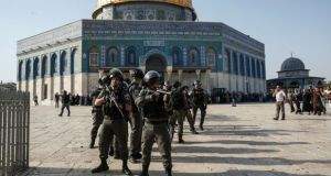 Israeli security forces in front of the Dome of the Rock in the Haram al-Sharif compound in the old city of Jerusalem. Photograph: Ahmad Gharabli/AFP/Getty Images