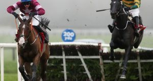 Mengli Khan ridden by Jack Kennedy (left) races clear of the last on the way to winning the Bar One Racing Royal Bond Novice Hurdle during day two of the Fairyhouse Winter Festival. Photograph: PA