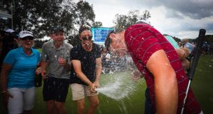 Cameron Smith gets a champagne shower following his victory in the Australian PGA Championship at the Royal Pines Resort on the Gold Coast. Photograph: Getty Images