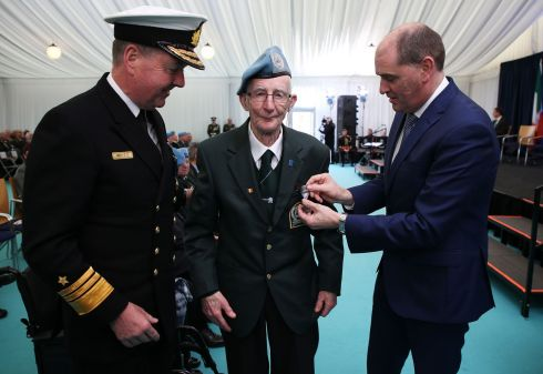 SIEGE OF JADOTVILLE: Thomas Cunningham, from Mullingar, receives his medal from Minister with responsibility for Defence Paul Kehoe (right) and Defence Forces chief of staff Chris Mellettat at Custume Barracks, Athlone. He received An Bonn Jadotville (The Jadotville Medal), at a ceremony for the veterans and relatives of those who served in A Company 35th Infantry Battalion and fought at the Battle of Jadotville in September 1961. Photograph: Brian Lawless/PA Wire