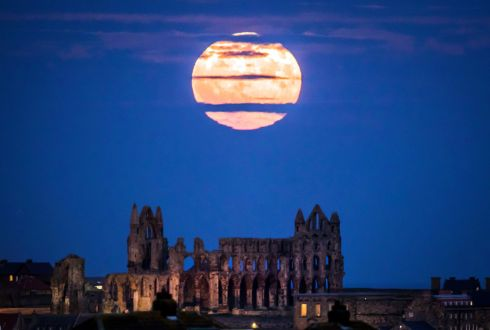HOWL AT THE MOON: The Supermoon rises above Whitby Abbey in Yorkshire. December's full moon will appear 14% bigger and 30% brighter than usual as it moves closer to Earth over the weekend. Photograph: Danny Lawson/PA Wire