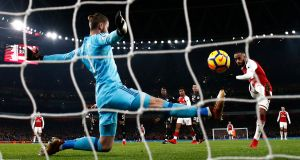 David De Gea of Manchester United makes a save from Alexandre Lacazette of Arsenal. Photograph: Julian Finney/Getty Images