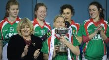 Carnacon's Cora Staunton kisses the Delores Tyrell cup before lifting it. Photograph: Oisin Keniry/Inpho