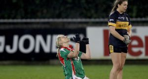 Carnacon's Cora Staunton with Aisling O'Sullivan of Mourneabbey at the final whistle. Photograph: Oisín Keniry/Inpho