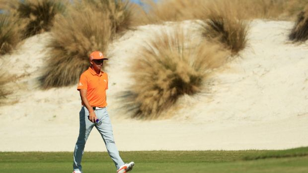 Rickie Fowler of the United States walks on the fourth hole during the final round of the Hero World Challenge. Photograph: Mike Ehrmann/Getty Images